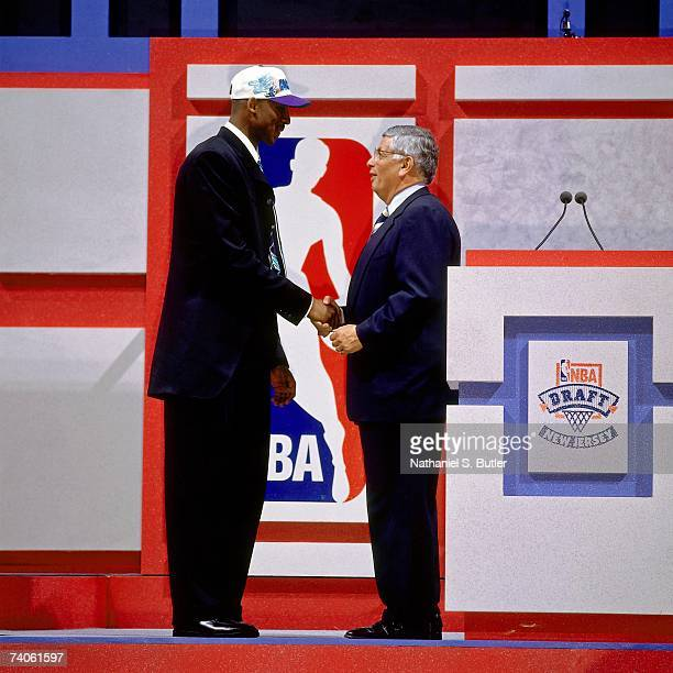 Kobe Bryant drafted by the Charlotte Hornets shakes NBA Commissioner David Stern's hand during the 1996 NBA Draft on June 26, 1996 at the Meadowlands...