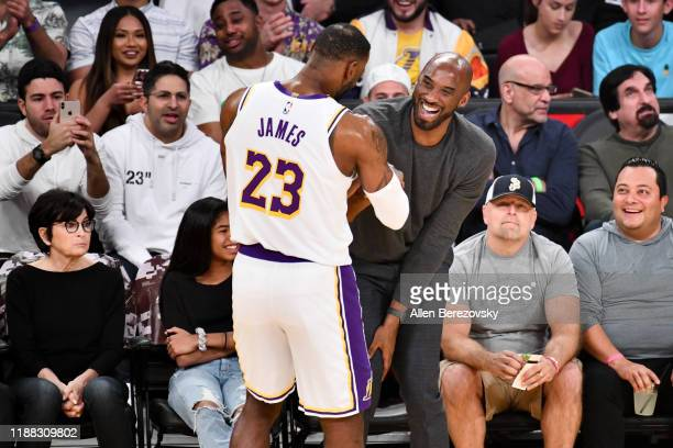 Kobe Bryant embraces LeBron James during a basketball game between the Los Angeles Lakers and the Atlanta Hawks at Staples Center on November 17 2019...
