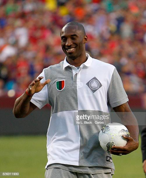 Kobe Bryant entertains during hafltime of the World Football Challenge Friendly match between FC Barcelona and Manchester United Manchester United...