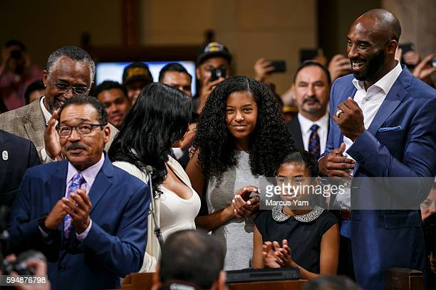 Kobe Bryant far right and his family his wife Vanessa Laine Bryant left and daughters Gianna Maria Onore Bryant center and Natalia Diamante Bryant...