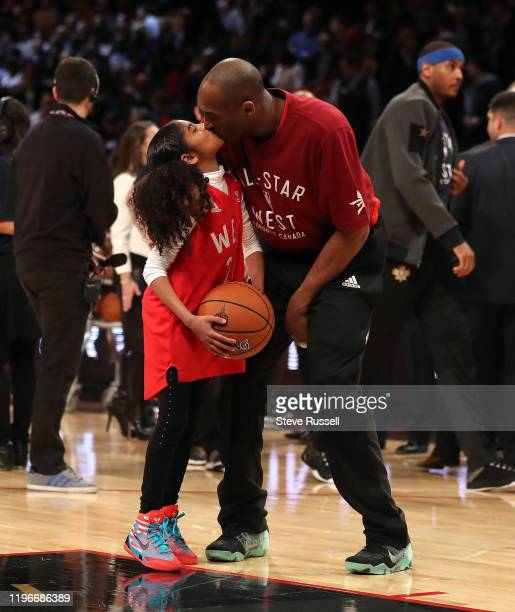 Kobe Bryant gets a kiss from his daughter Gianna Bryant during the 65th NBA AllStar Game at the Air Canada Centre in Toronto February 14 2016