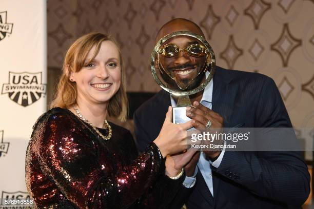 Kobe Bryant holds Katie Ledecky's Golden Goggle Award for Female Athlete of the Year during the 2017 USA Swimming Golden Goggle Awards at JW Marriott...
