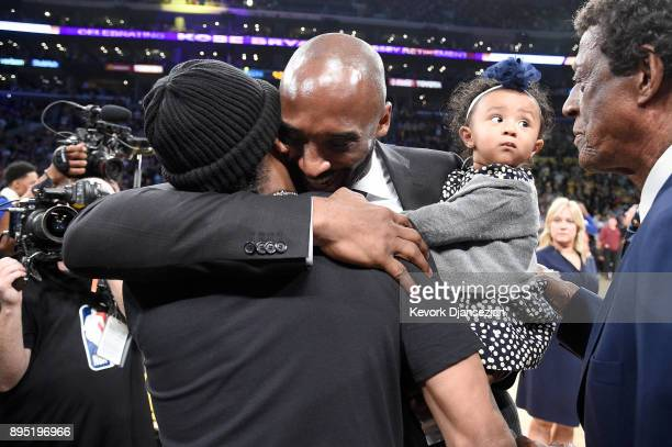 Kobe Bryant hugs Allen Iverson at halftime after both of Bryant's and Los Angeles Lakers jerseys are retired at Staples Center on December 18 2017 in...