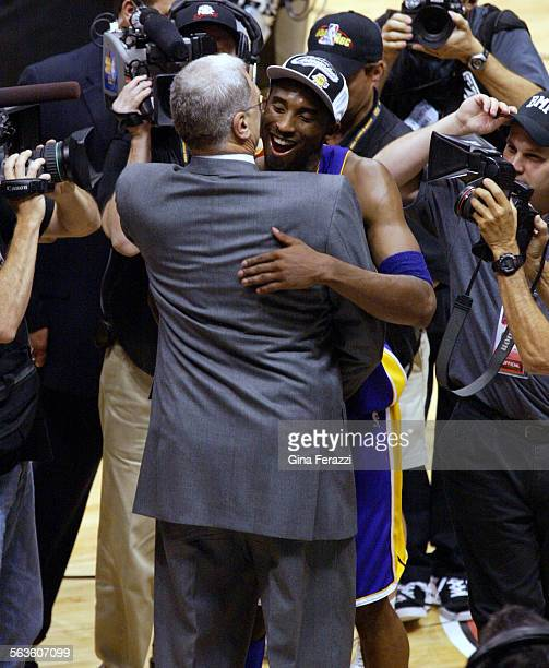 Kobe Bryant hugs cach Phil Jackson after the Lakers won the NBA Championship in East Rutherford New Jersey on June 12 2002