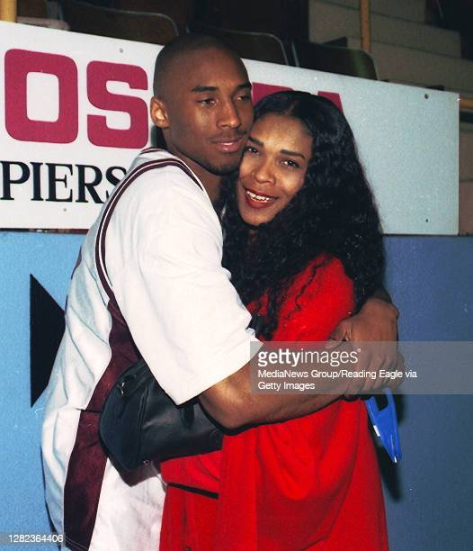 Kobe Bryant hugs his mother Pam Bryant after winning the basketball title at the Hershey arena on March 23, 1996 against Cathedral Prep 48-43.