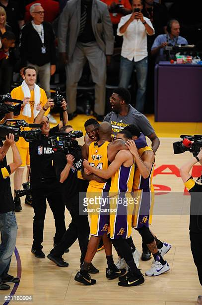 Kobe Bryant hugs Julius Randle, Jordan Clarkson and D'Angelo Russell of the Los Angeles Lakers shoots against the Utah Jazz at STAPLES Center on...