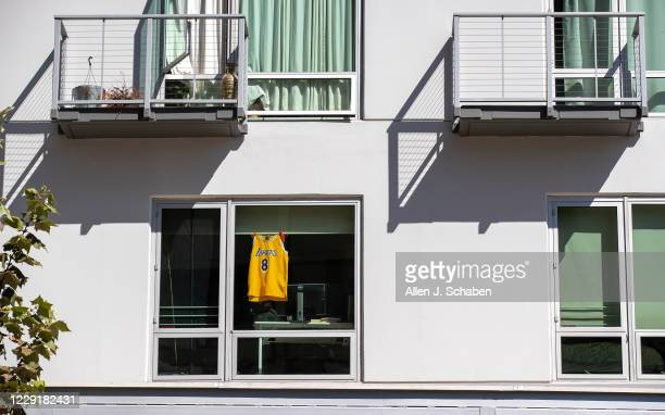 Kobe Bryant jersey hangs in a window following the Lakers championship win on Monday, Oct. 12, 2020 in downtown Los Angeles, CA.