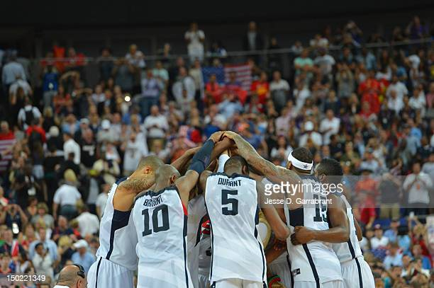 Kobe Bryant Kevin Durant Carmelo Anthony and the rest of the US Men's Senior National Team huddles against Spain during their Men's Gold Medal...