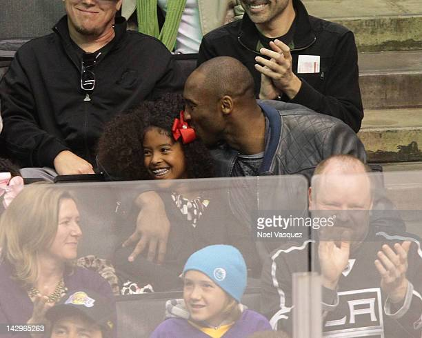 Kobe Bryant kisses Natalia Diamante Bryant at a playoff hockey game between the Vancouver Canucks and the Los Angeles Kings at Staples Center on...