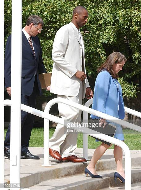 Kobe Bryant leaves the Eagle County Courthouse with his attorney Hal Haddon and lead attorney Pamela Mackey following his advisement hearing Bryant...