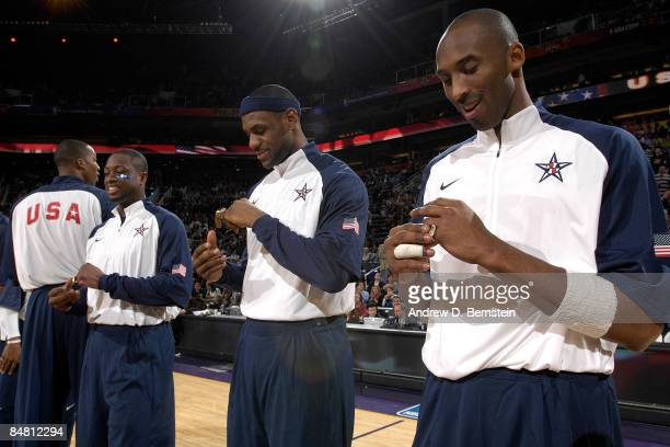 Kobe Bryant LeBron James and Dwyane Wade receive a ring for being members of the USA Men's Basketball team which won the Gold Medal at the 2008...