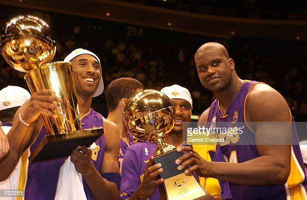 Kobe Bryant Lindsey Hunter and Shaquille O'Neal of the Los Angeles Lakers celebrate after winning the 2002 NBA Championship against the New Jersey...