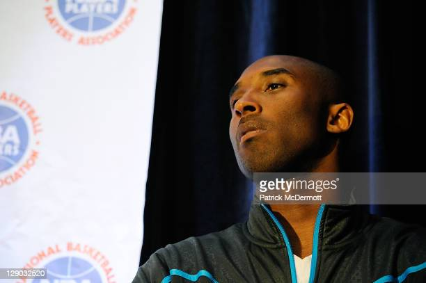 Kobe Bryant listens as Derek Fisher President of the National Basketball Players Association speaks at a press conference after NBA labor...