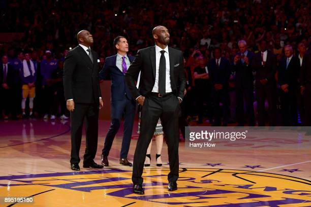 Kobe Bryant looks up at the rafters at halftime as both his and Los Angeles Lakers jerseys are retired at Staples Center on December 18 2017 in Los...