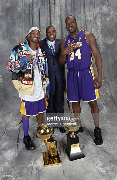Kobe Bryant, Magic Johnson and Shaquille O'Neal of the Los Angeles Lakers pose for a portrait after winning the 2002 NBA Championship against the New...