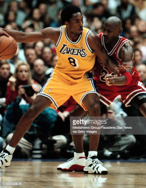 Kobe Bryant of the Lakers goes up against Michael Jordan of the Bulls in the lakers Sunday afternoon win