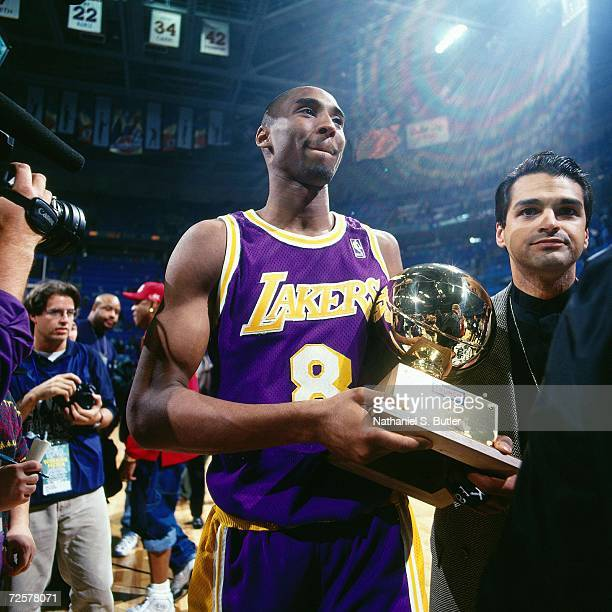 Kobe Bryant of the Lakers poses with his trophy after winning the 1997 Nestle Crunch Slam Dunk Contest on February 8 1997 at the Gund Arena in...