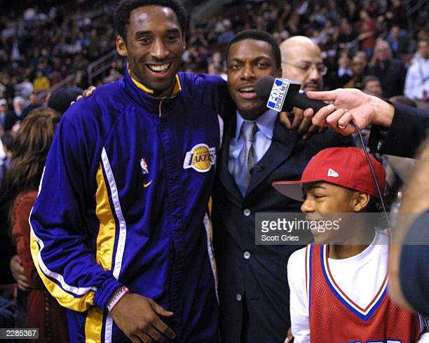 Kobe Bryant of the LA Lakers with Chris Tucker and Lil' Bow Wow at the NBA AllStar Game at the First Union Center in Philadelphia Pa 2/10/02 Photo by...