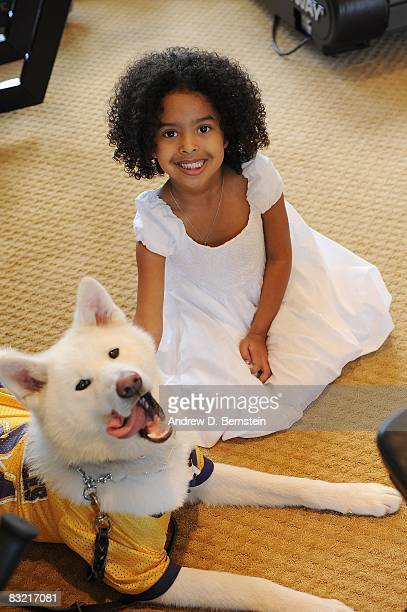 Kobe Bryant of the Los Angeles daughter Natalia Bryant sits with the family dog during a photo session on March 29, 2008 at his home in Newport...