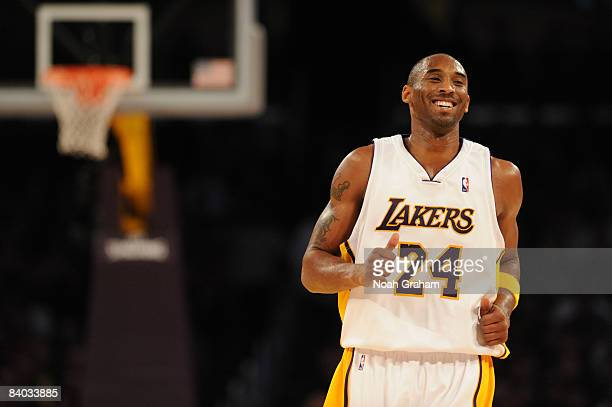 Kobe Bryant of the Los Angeles Laker smiles while backpedaling on defense against the Minnesota Timberwolves at Staples Center on December 14 2008 in...