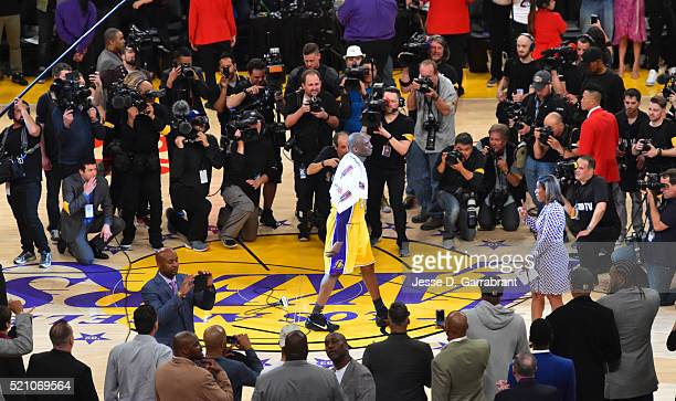 Kobe Bryant of the Los Angeles Lakers addresses the crowd and drops the mic to signify that Kobe is finally done with basketball against the Utah...
