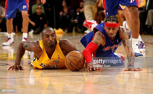 Kobe Bryant of the Los Angeles Lakers and Allen Iverson of the Detroit Pistons dive for a loose ball on November 14 2008 at Staples Center in Los...