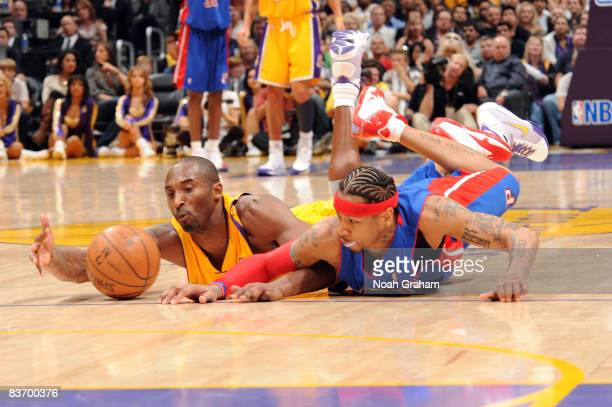 Kobe Bryant of the Los Angeles Lakers and Allen Iverson of the Detroit Pistons dive for a loose ball during their game at Staples Center on November...