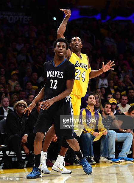 Kobe Bryant of the Los Angeles Lakers and Andrew Wiggins of the Minnesota Timberwolves react to a Bryant shot during the first quarter at Staples...
