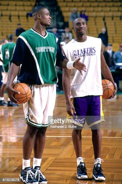 Kobe Bryant of the Los Angeles Lakers and Antoine Walker of the Boston Celtics speak during a game played on November 17 1996 at the FleetCenter in...