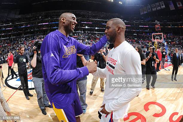 Kobe Bryant of the Los Angeles Lakers and Chris Paul of the Los Angeles Clippers shake hands after the game on April 5 2016 at STAPLES Center in Los...