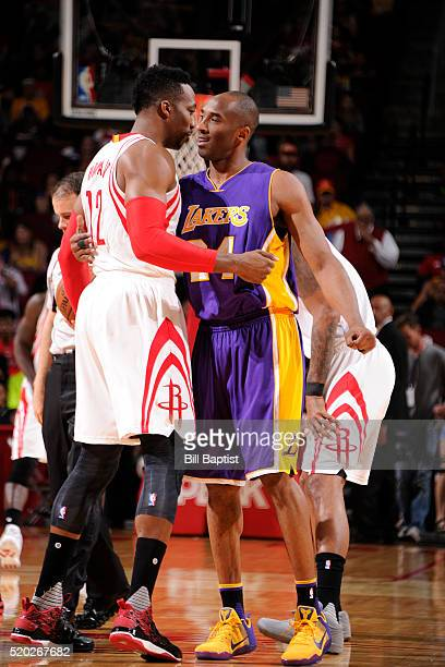 Kobe Bryant of the Los Angeles Lakers and Dwight Howard of the Houston Rockets shake hands before the game on April 10 2016 at the Toyota Center in...