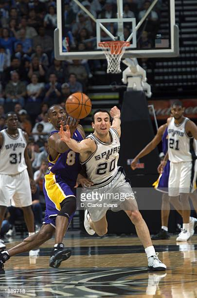 Kobe Bryant of the Los Angeles Lakers and Emanuel Ginobili of the San Antonio Spurs reach for a loose ball during the game at SBC Center on March 23...