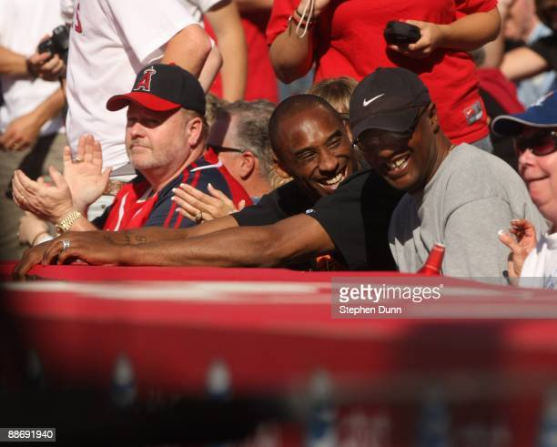 Kobe Bryant of the Los Angeles Lakers and father Joe Bryant attend the game between the Los Angeles Angels of Anaheim and the Los Angeles Dodgers on...