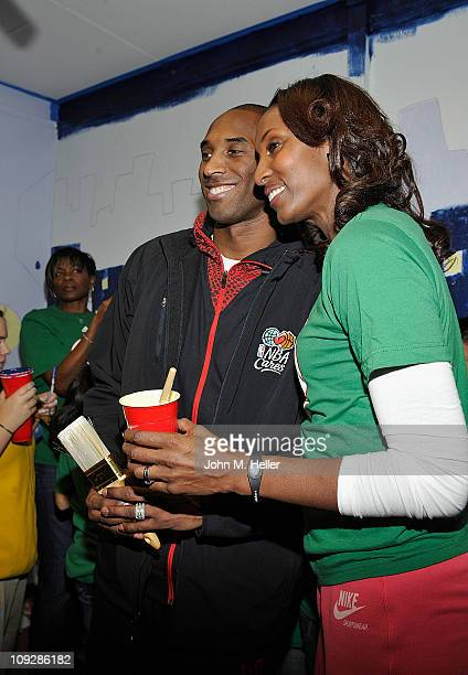 Kobe Bryant of the Los Angeles Lakers and former Los Angeles Sparks WNBA player Lisa Leslie attend the NBA Cares AllStar Day of Service with City...