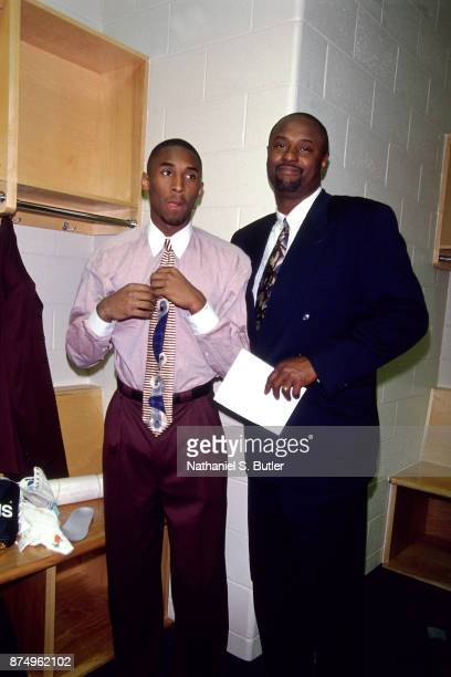 Kobe Bryant of the Los Angeles Lakers and his dad Joe Bryant pose in the locker during a game played on November 26 1996 at the First Union Arena in...