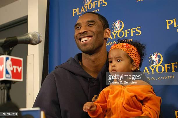 Kobe Bryant of the Los Angeles Lakers and his daughter Natalia during the post game press conference following game five of the Western Conference...