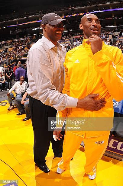 Kobe Bryant of the Los Angeles Lakers and his father, Joe share a moment before a game against the Oklahoma City Thunder in Game Two of the Western...