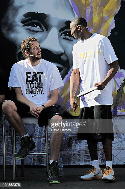 Kobe Bryant of the Los Angeles Lakers and his teammate Pau Gasol react during the 'House of Hoops' contest by Foot Locker on October 6, 2010 in...