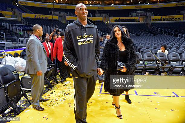 Kobe Bryant of the Los Angeles Lakers and his wife Vanessa Bryant walk onto the court after the game against the Utah Jazz on April 13 2016 at...