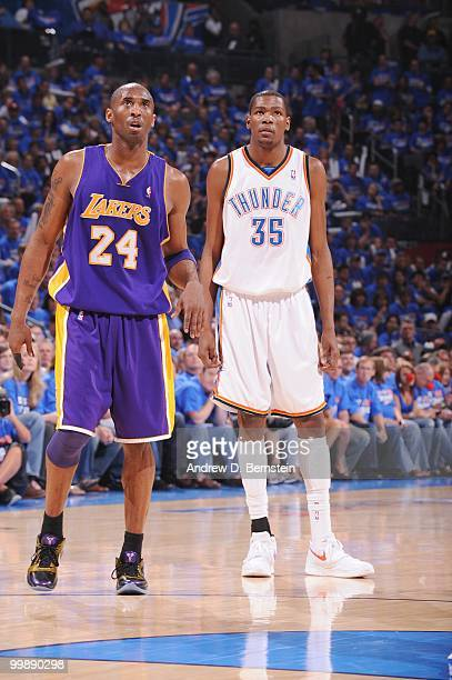 Kobe Bryant of the Los Angeles Lakers and Kevin Durant of the Oklahoma City Thunder follow the action in Game Six of the Western Conference...