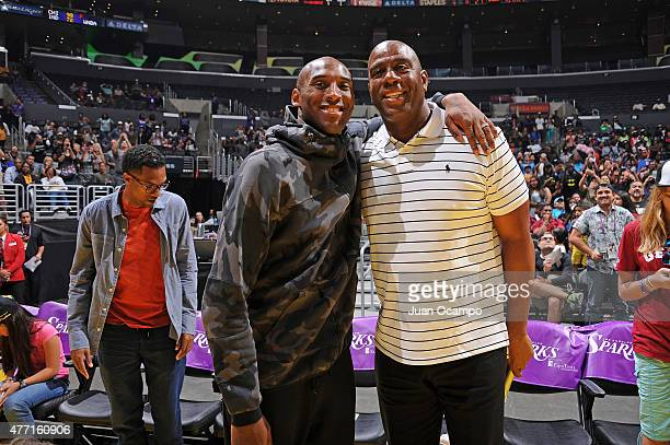 Kobe Bryant of the Los Angeles Lakers and Magic Johnson during the game between the Seattle Storm and the Los Angeles Sparks on June 14 2015 at...