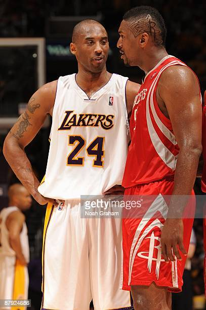 Kobe Bryant of the Los Angeles Lakers and Ron Artest of the Houston Rockets talk on the court in Game Seven of the Western Conference Semifinals...