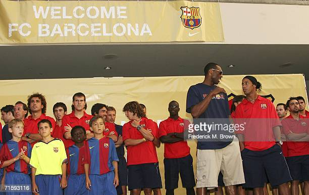 Kobe Bryant of the Los Angeles Lakers and Ronaldinho of Brazil speak at Nike European Club Champion FC Barcelona Rally at Hollywood and Highland on...