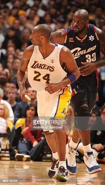 Kobe Bryant of the Los Angeles Lakers and Shaquille O'Neal of the Cleveland Cavaliers run up the floor during their game at Staples Center on...