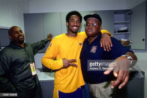 Kobe Bryant of the Los Angeles Lakers and Shaquille O'Neal's dad pose during a game played circa 2000 at the Staples Center in Los Angeles,...