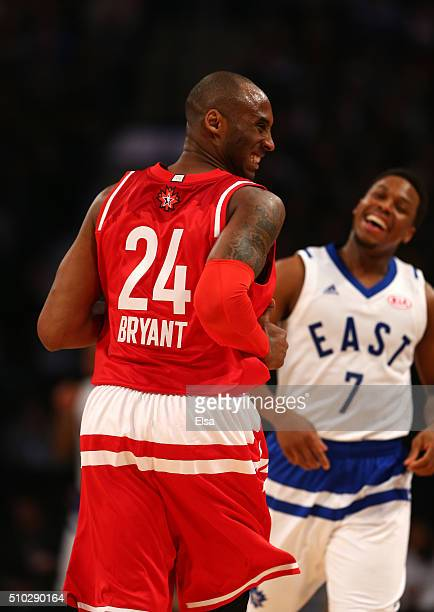 Kobe Bryant of the Los Angeles Lakers and the Western Conference reacts after a play in the first half against Kyle Lowry of the Toronto Raptors and...