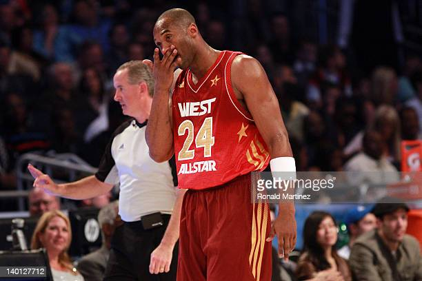 Kobe Bryant of the Los Angeles Lakers and the Western Conference reacts after he drew blood on the receiving end of a hard foul against Dwyane Wade...