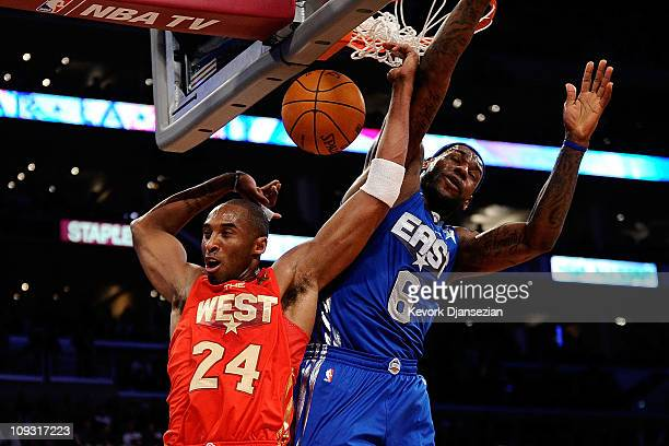 Kobe Bryant of the Los Angeles Lakers and the Western Conference dunks in front of LeBron James of the Miami Heat and the Eastern Conference in the...