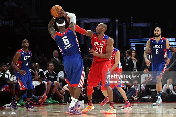 Kobe Bryant of the Los Angeles Lakers and the Western Conference plays defense on LeBron James of the Miami Heat and the Eastern Conference in the...