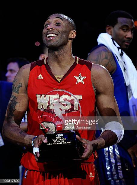 Kobe Bryant of the Los Angeles Lakers and the Western Conference celebrates after being named MVP for the fourth time in the 2011 NBA AllStar Game at...